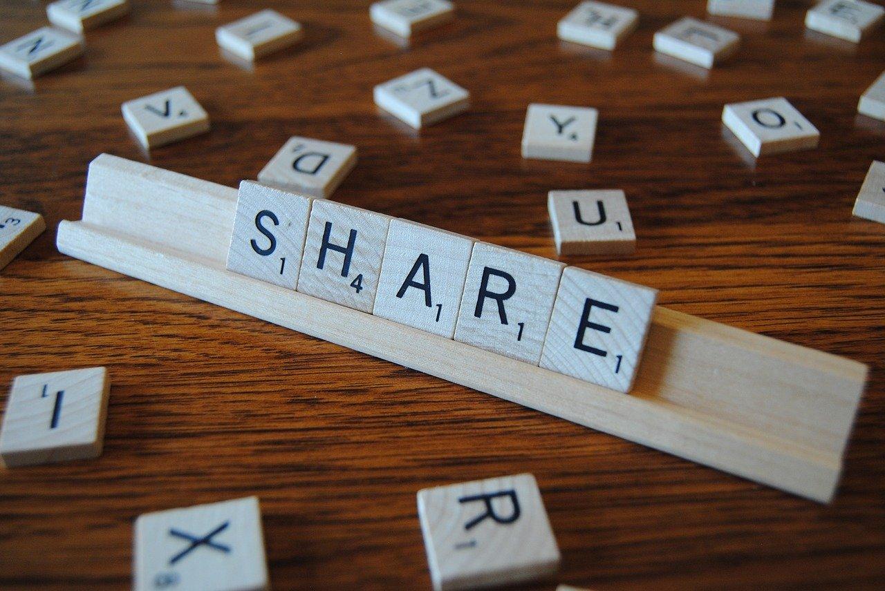 Scrabble tiles spelling share